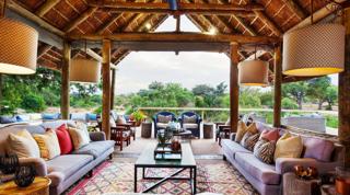 a lounge area in a bush lodge