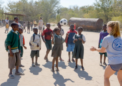 school children playing with a ball in a school yard